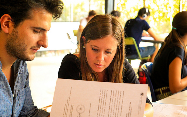 Two students looking at paperwork