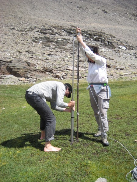 Two researchers conducting experiments in the Sierra Nevada mountain range