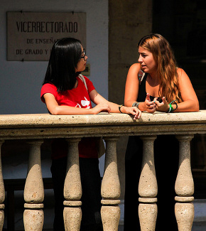 Two students chatting outside a university building