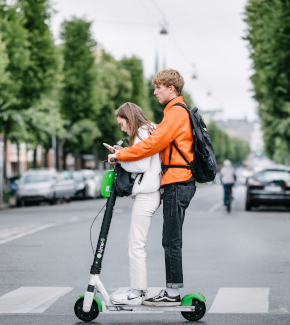 Two young people on an electric scooter